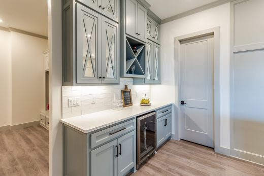 simple sky blue cabinetry with white accents at carpentry cairns